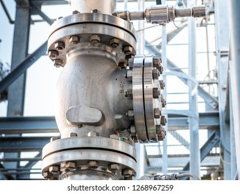 large globe valve, with flanges and bolts, on high pressure water cooling system pipes on industrial plant, vertical installation, side view