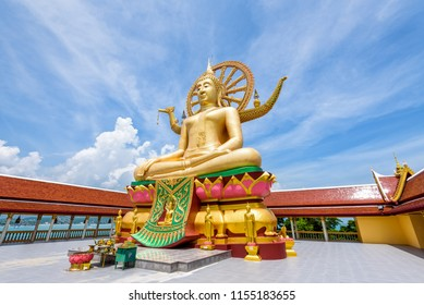 Large gold buddha statue in a sitting position under the blue sky at Big Buddha Temple is a famous tourist destination of Koh Samui island, Surat Thani province, Thailand