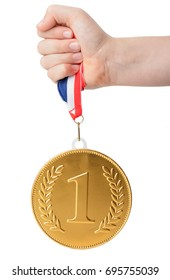 A large gold number one medal held up