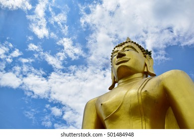 The large golden Buddha on the background of the sky. /With copy space. /public areas