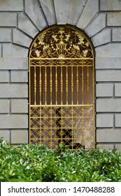 Large golden gates on building