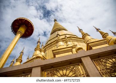 Large golden temple with sky background, Name is Phra Maha Chedi Srivang Chai, Located in Lamphun, Thailand. Phra Maha Chedi Srivang Chai, Golden temple for buddhism to pray for faith
