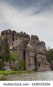 Large granite rock formations along the shoreline of  Sylvan Lake in South Dakota.