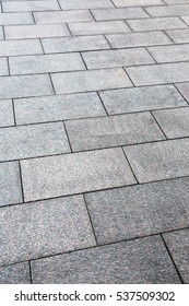 large granite slabs on the sidewalk