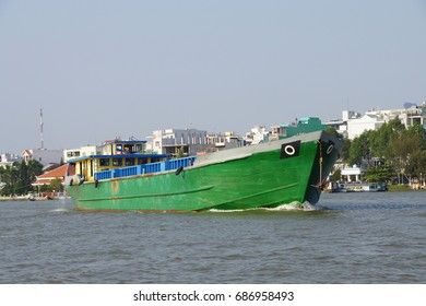 Large green cargo boat outbound from the floating market, Cai Rang,  Vietnam