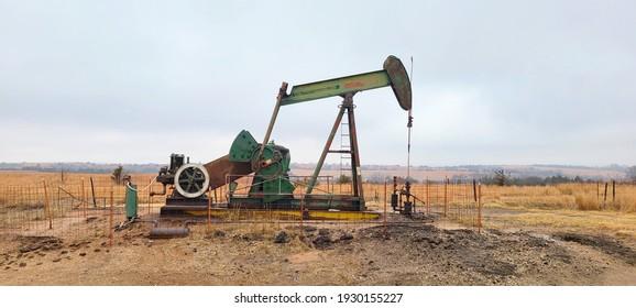 Large Green Pumpjack in an Oil Field
