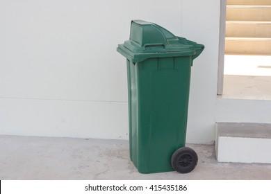 large green wheelie bin for rubbish,Public trash background