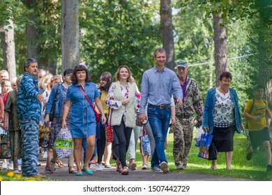 A large group of adults are in the woods. Parents visit children in the recreation camp. Russia. Yaroslavl oblast, city Rybinsk, Matrosova camp. 18.07.2019