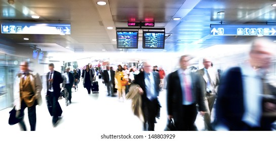 A large group of arriving business people. Panorama. Motoin blur.