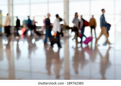 A large group of arriving passengers. Panorama. Motion blur. Airport.