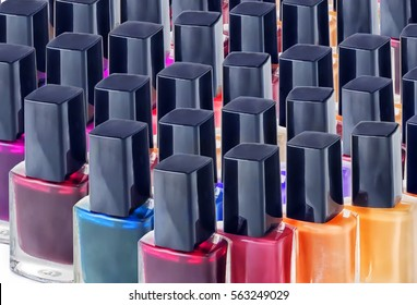 Large Group of bright colorful nail polishes isolated on white