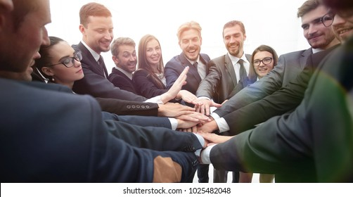 large group of business people standing with folded hands togeth