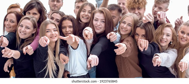 large group of casual young people pointing ahead