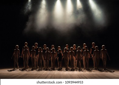a large group of children have a reverence at the end of the performance.