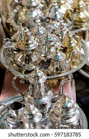 Large group, collection, of silver platted arabic mint tea pots. Close up vertical composition