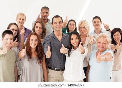 A large group of different people showing thumbs up together.