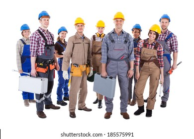 Large group of diverse workmen and women standing isolated on white
