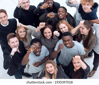 large group of diverse young people looking at the camera .