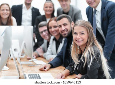 large group of employees in the workplace in the office