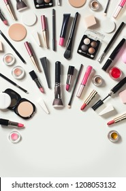Large group flat lay view of cosmetic beauty retail products on white background. Text space image.