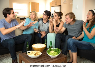 Large group of friends at a party get together house drinking beer chatting storytelling gossiping