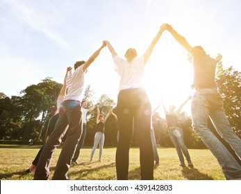 large group of friends together in a park having fun