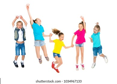 A large group of happy joyful children jumps and dances. The concept of sport, summer holidays. Isolated on white background.