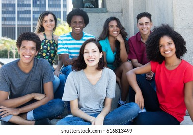 Large group of happy multiethnic young men and women