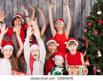 Large Group of happy people in Christmas hat making cheer