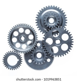 A large group of interlocking gears with small teeth over a plain white background.