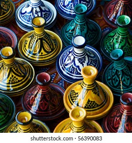 Large group of Israeli colorful ceramic candlesticks. The simple form, glazed surface, shining colors, east ornament. Good for background. Jerusalem flea market.