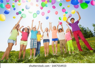 Large group of kids with air balloons