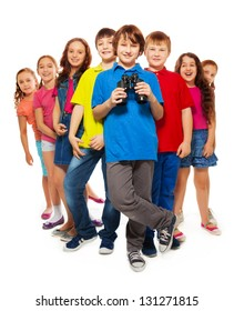 Large group of kids with confident happy boy holding binoculars