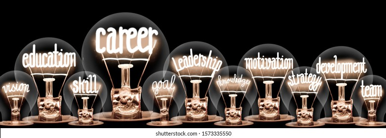 Large group of light bulbs with shining fibers in a shape of Career, Leadership, Motivation, Education and Development concept related words isolated on black background