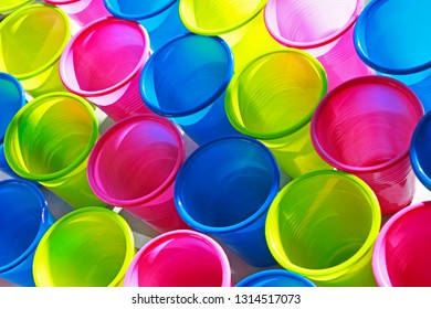large group of multi colored plastic cups, colorful pattern,