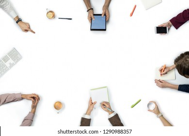 Large group of people at business meeting, top view. Flat lay with copy space of diverse people hands around a table.