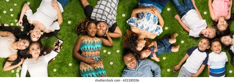 Large group of people laying in the grass