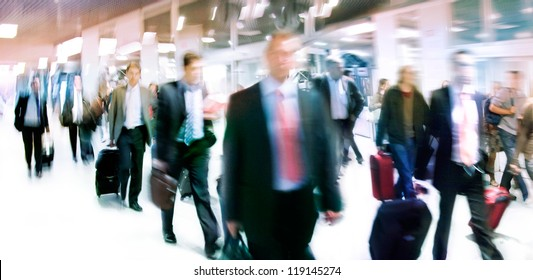 A large group of people. Panorama. People walking against a light background. Motion blur.