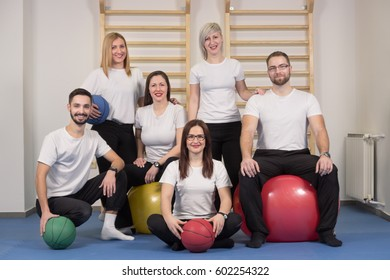 large group people, Physiotherapists chiropractors, indoors portrait, sitting standing, exercise balls