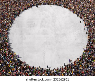Large group of people seen from above, gathered in the shape of a circle, standing on a concrete background