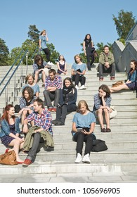 Large group of people sitting in the stairs