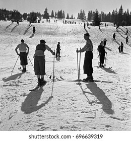 Large group of people skiing on snowy hills