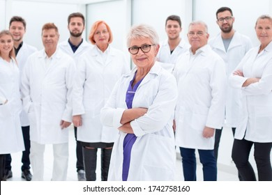 large group of people in white coats standing together.