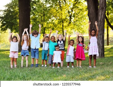 A large group of preschool children playing in the Park on the grass. The concept of friendship, childhood.Children's day, June 1