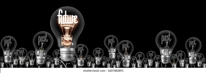 Large group of shining and dimmed light bulbs with fibers in a shape of Past and Future words isolated on black background. Concept of Innovation, Motivation and Success