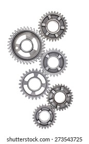 A large group of steel gears are linked together on a white background.