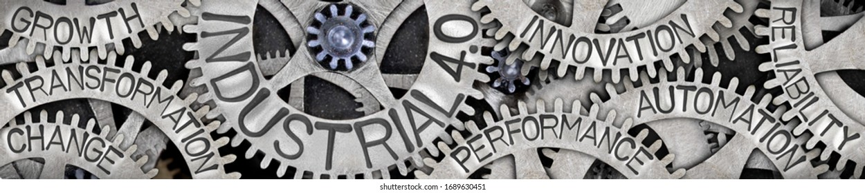 Large group of tooth wheels with Industrial 4.0, Innovation, Automation, Transformation and Growth concept related words imprinted on metal surface; horizontal composition
