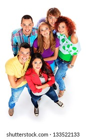 A large group of young people standing together and looking up. Friendship. Isolated over white.