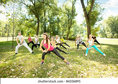 large group of young people stretching outdoor