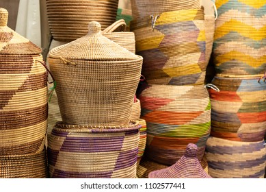 Large hand-made colored baskets in an African market, horizontal image
